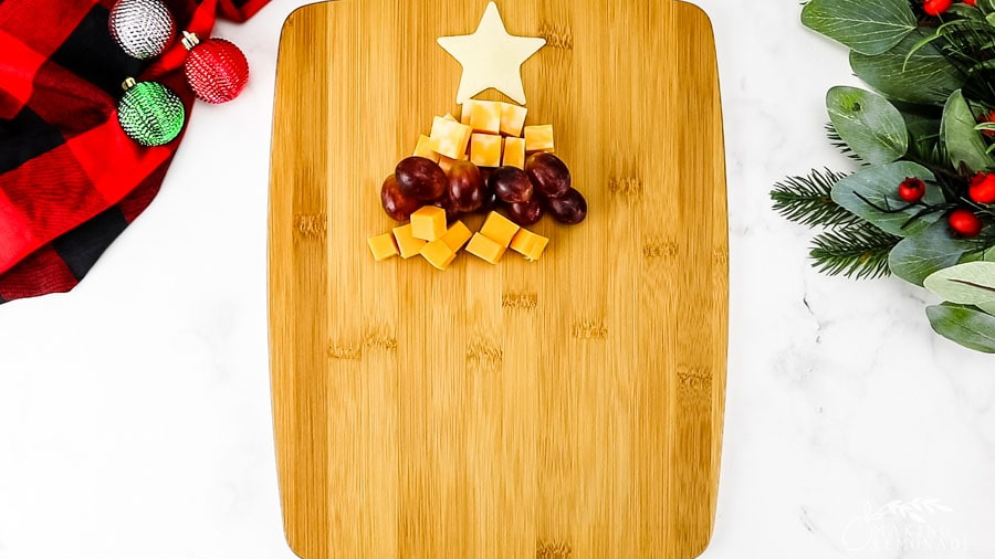 the top of a tree shaped cheese board