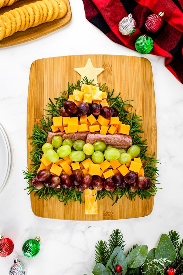 meat and cheese board in the shape of a Christmas tree