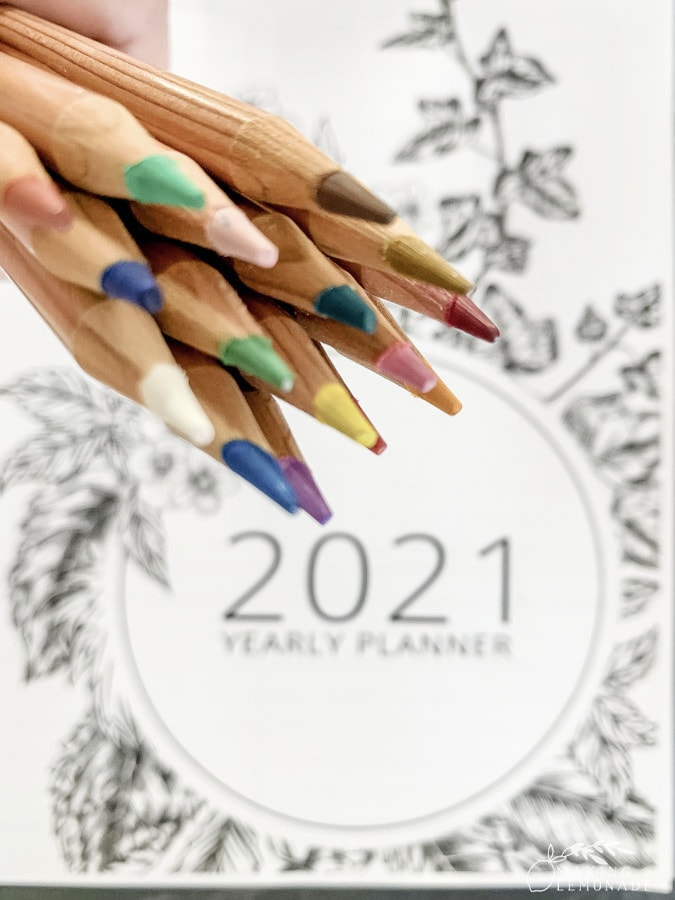 planner with colored pencils
