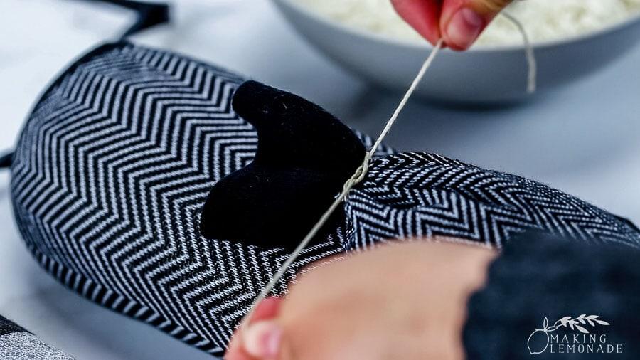 tying off DIY rice sock