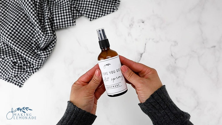 bottle of DIY poo pourri toilet spray with homemade label