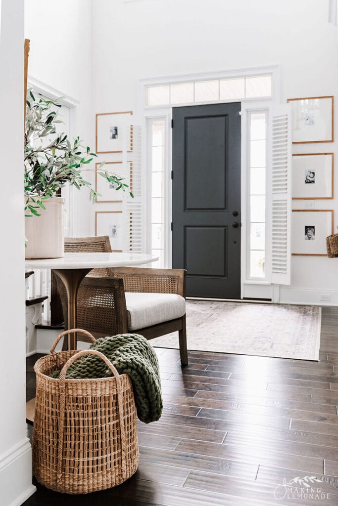 two story entryway with basket and table