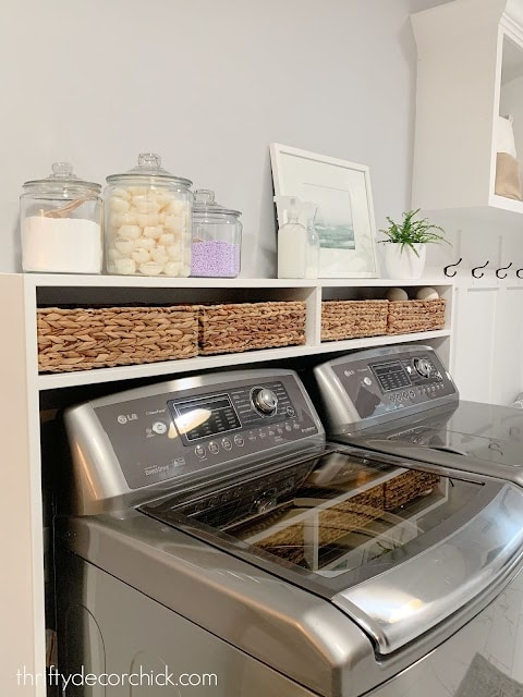 DIY shelves above washer and dryer in laundry room