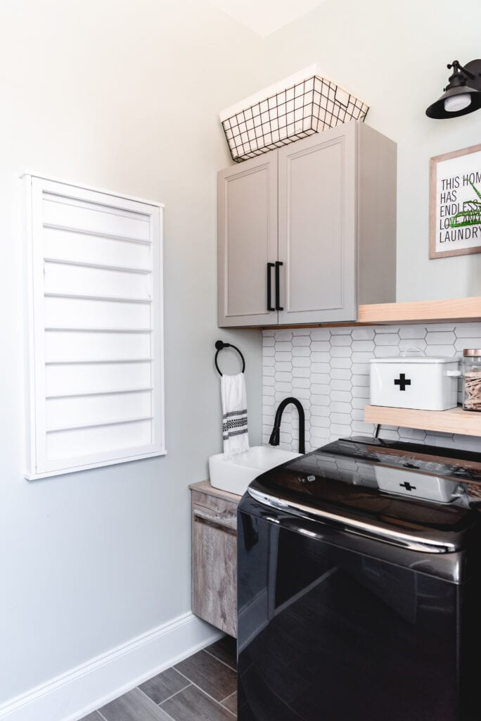 wall mounted drying rack in laundry room